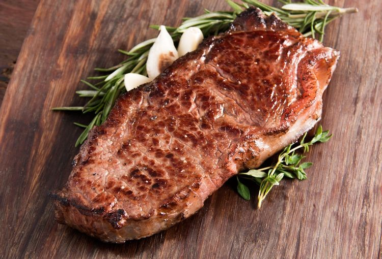 new york strip steak from pureland america fried in butter