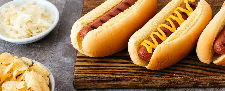 organic hot dog in bun with mustard